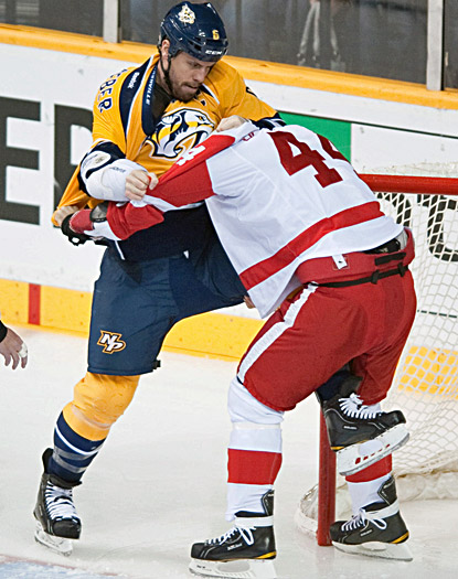 Nashville's Shea Weber (left) and Detroit's Todd Bertuzzi exchange blows 1:36 into the game. (US Presswire)