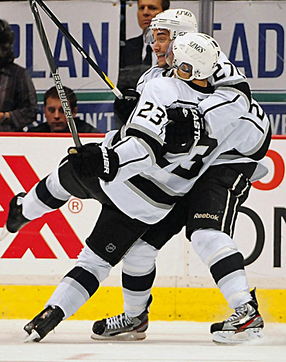 Alec Martinez (left) congratulates Dustin Brown, who ties an NHL playoff record with two short-handed goals. (US Presswire)