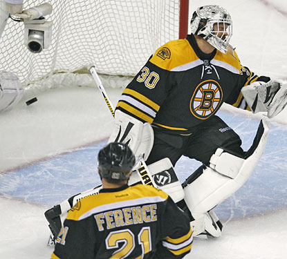 After 37 saves, Tim Thomas lets the Caps' second goal get past him in the second overtime period.  (AP)