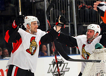 The Senators' Nick Foligno (left) celebrates after his game-tying goal in the third period against the Rangers. (Getty Images)