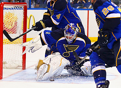 Brian Elliott doesn't start in goal for the Blues, but stops 17 shots to blank the Sharks. (Getty Images)