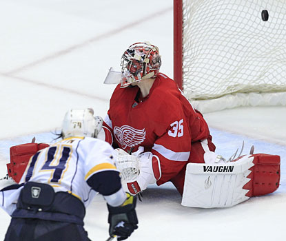 Sergei Kostitsyn scores the game-clinching goal, beating Wings goalie Jimmy Howard late in the third period.  (AP)