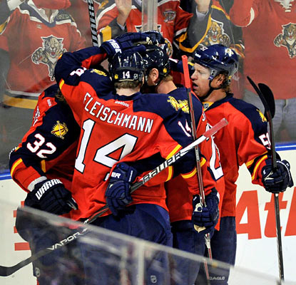 Stephen Weiss (not shown) is mobbed by teammates after he scores in the opening period. He finishes with two goals. (US Presswire)