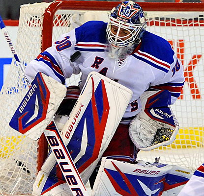 Henrik Lundqvist makes one of his 39 saves against the Senators to help the Rangers win Game 3. (US Presswire)