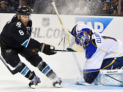Joe Pavelski tries to score during the second period for the Sharks, but the Blues' Brian Elliott is up to the task. (US Presswire)