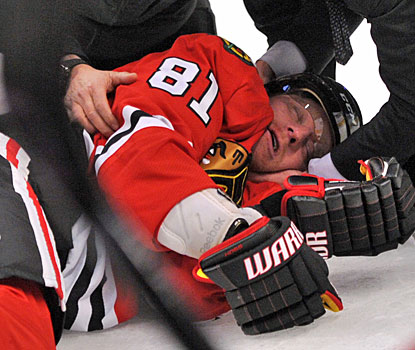 Marian Hossa is knocked out of the game after taking a big hit from Raffi Torres in the first period.  (US Presswire)
