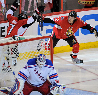 Jim O'Brien (42) awaits Kyle Turris (7), who beats Henrik Lundqvist for the winner less than three minutes into overtime. (AP)