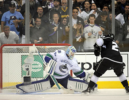Cory Schneider is almost perfect in Game 4, stopping 43 shots, including a penalty shot by Dustin Brown. (Getty Images)