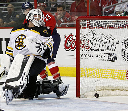 Tim Thomas is unable to stop Alexander Semin's wrist shot during Washington's third power-play opportunity in the game. (AP)