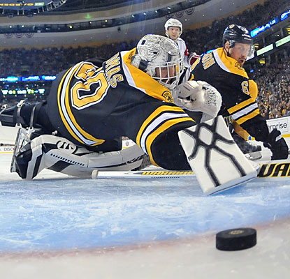 Tim Thomas stops 28 of 32 shots as the Bruins never hold a lead in regulation for the fourth time in five games.  (Getty Images)
