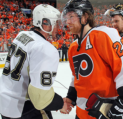 Sidney Crosby congratulates series star Claude Giroux (14 points in six games) in the postgame handshake line.  (Getty Images)