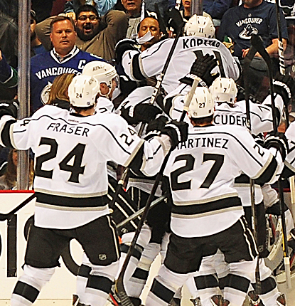 Jarret Stoll (not pictured) gets mobbed by teammates after helping the Kings knock out the Canucks in OT. (US Presswire)