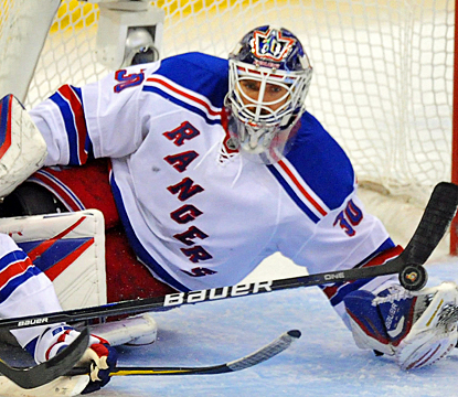 Henrik Lundqvist makes a save during the second period against the Senators. (AP)