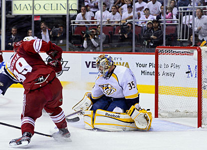 Mikkel Boedker shoots the puck over Predators goalie Pekka Rinne's right shoulder for his third goal in this postseason. (US Presswire)