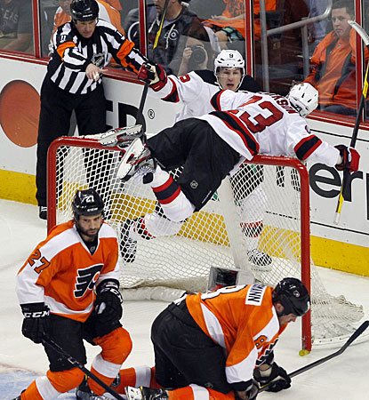 David Clarkson (23) is on top of the net, which is knocked off its moorings after he scores the winning goal. (AP)