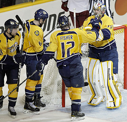 Pekka Rinne gets plenty of credit from his teammates, including Mike Fisher, who scores his first goal this postseason. (AP)