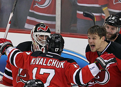 Martin Brodeur, Ilya Kovalchuk and Alexei Ponikarovsky (right) celebrate the big victory. (US Presswire)