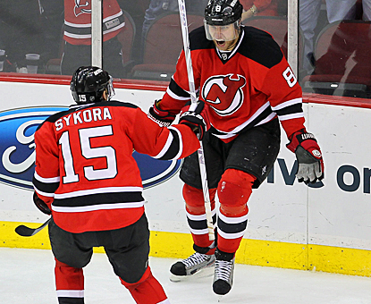 The Devils' Danius Zubrus (right) celebrates the first of his two goals against the Flyers in Game 4. (US Presswire)