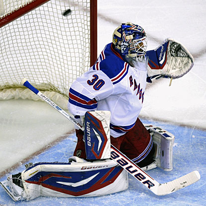 Henrik Lundqvist is beaten high to the glove side by a shot from Alexander Ovechkin for the Capitals' first goal. (AP)