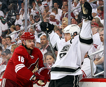Dustin Brown celebrates after scoring his seventh goal of the playoffs and first against the Coyotes in the West finals. (Getty Images)