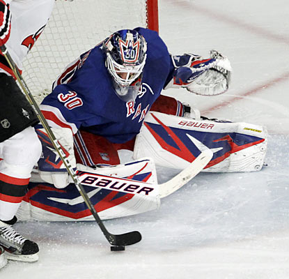 The Devils can't get the puck past Henrik Lundqvist, who earns his fifth career playoff shutout. (AP)