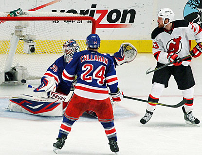 David Clarkson (23) uses good hand-eye coordination to tip the puck down past Henrik Lundqvist for the winning goal. (Getty Images)