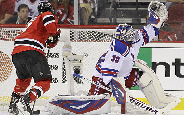 For the second time in three games, Henrik Lundqvist stops every shot from the Devils. (AP)