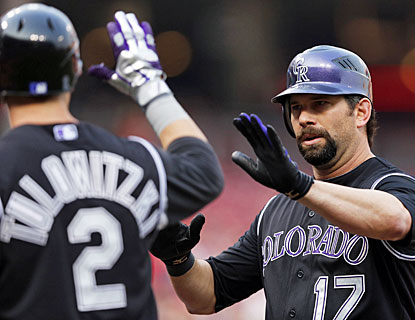 Todd Helton smacks his first home run since April 29 and drives in three runs for the Rockies. (Getty Images)