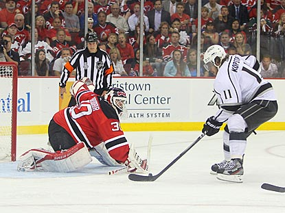 Anze Kopitar gets Martin Brodeur to commit, which makes it easier for the Kings center to score on a breakaway in overtime.  (US Presswire)