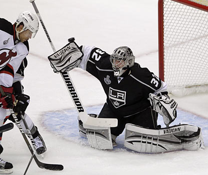 Jonathan Quick deflects a shot and finishes with 22 saves as the Kings annihilate the Devils in Game 3. (AP)