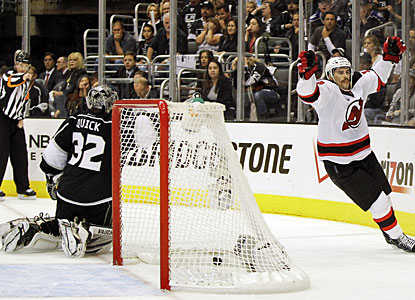 Adam Henrique's fourth goal of the postseason comes at just the right time for New Jersey. (AP)