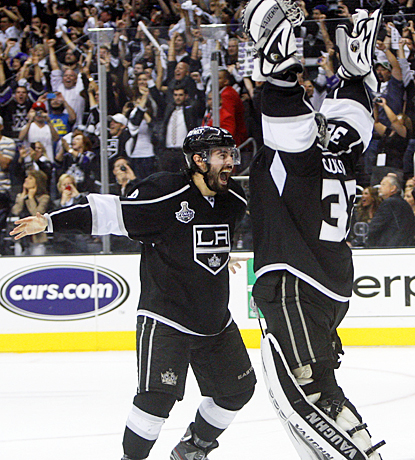 Drew Doughty (left) celebrates with Jonathan Quick after clinching the Stanley Cup in Game 6 against the Devils. (US Presswire)