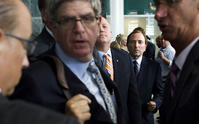 Gary Bettman and the NHL are threatening to impose the league's third lockout in 17 years. (AP)