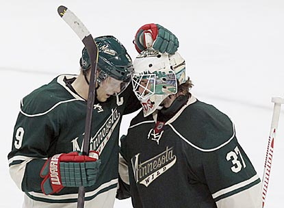 Minnesota captain Mikko Koivu congratulates Josh Harding, who provides a shutout for the Wild and inspiration for everyone.  (AP)