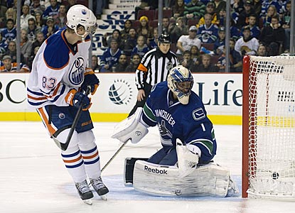 Edmonton's Ales Hemsky ends the shootout by putting the puck past Vancouver's Roberto Luongo.  (Getty Images)