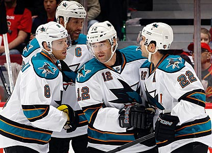 San Jose's Patrick Marleau (12), a Shark since 1997, receives congratulations on one of his two second-period goals.  (Getty Images)