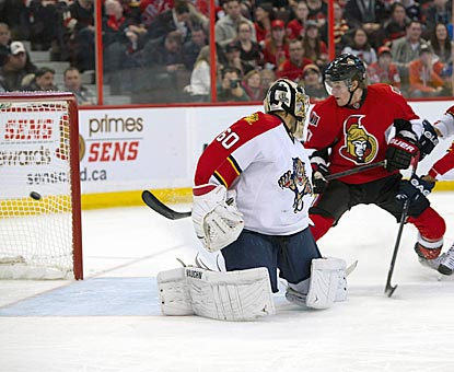 Ottawa center Kyle Turris puts the puck past Florida goalie Jose Theodore during the second period. (US Presswire)