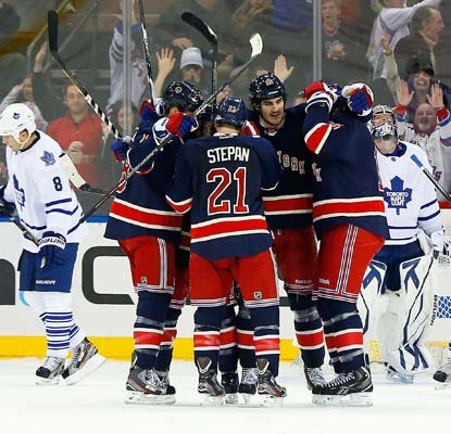 Brian Boyle celebrates his third-period goal as the Rangers finish with a flourish to secure the win.  (Getty Images)