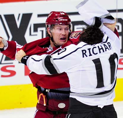 The Kings' Mike Richard and the Coyotes' Shane Doan go at in the third period of Los Angeles' first win of the season.  (US Presswire)