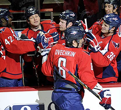 Alex Ovechkin celebrates his first goal with his teammates on the bench.  (AP)
