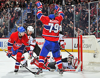 Andrei Markov celebrates his winning goal against the Devils' Martin Brodeur in overtime. (Getty Images)