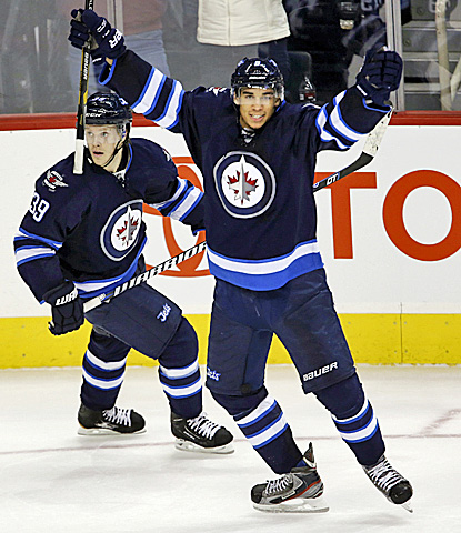 The Jets' Evander Kane (right) celebrates his winning goal against the Islanders.  (AP)