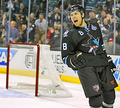 San Jose's Joe Pavelski celebrates after scoring one of his two goals against the Canucks. (AP)