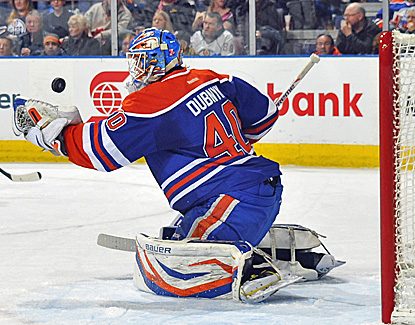 Devan Dubnyk makes one of his 37 saves against the Avalanche in the Oilers' 4-1 win. (Getty Images)