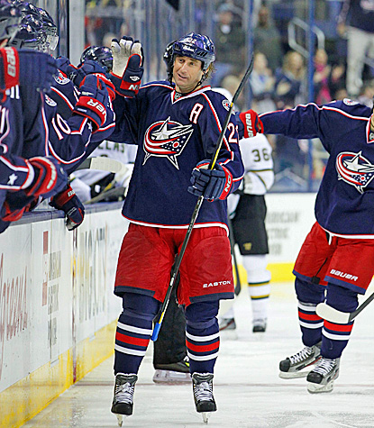 Vinny Prospal celebrates with teammates after scoring the game-winning goal against the Stars. (US Presswire)