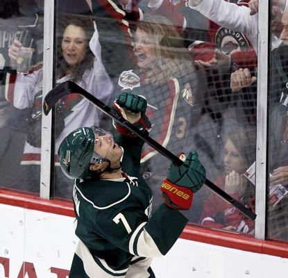 Matt Cullen celebrates with Wild fans after his quick-strike goal 90 seconds into the game.  (AP)