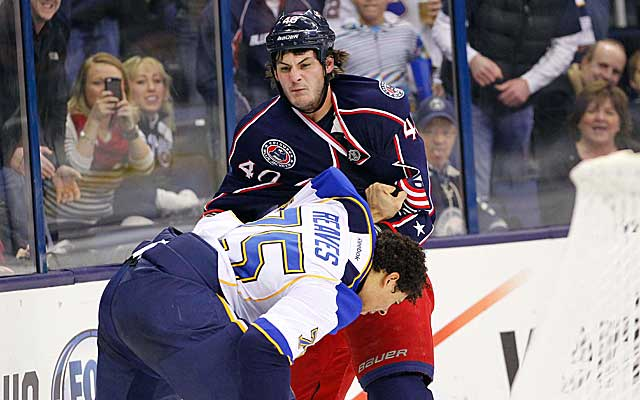 Columbus winger Jared Boll and St. Louis' Ryan Reaves go at it Thursday night. (US Presswire)