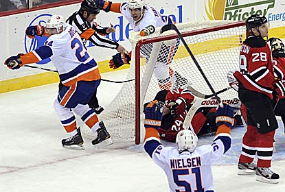 Brad Boyes (left) gets the game winner past Martin Brodeur as the Isles avenge their opening-night loss. (AP)