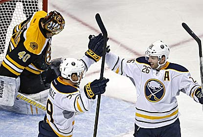 Thomas Vanek (right) -- getting kudos from Jason Pominville -- also has two assists to go with his three goals in the win. (AP)