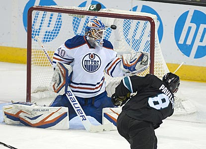 San Jose's Joe Pavelski zips a shot over Edmonton's Devan Dubnyk's glove shoulder for a goal during the second period.  (US Presswire)